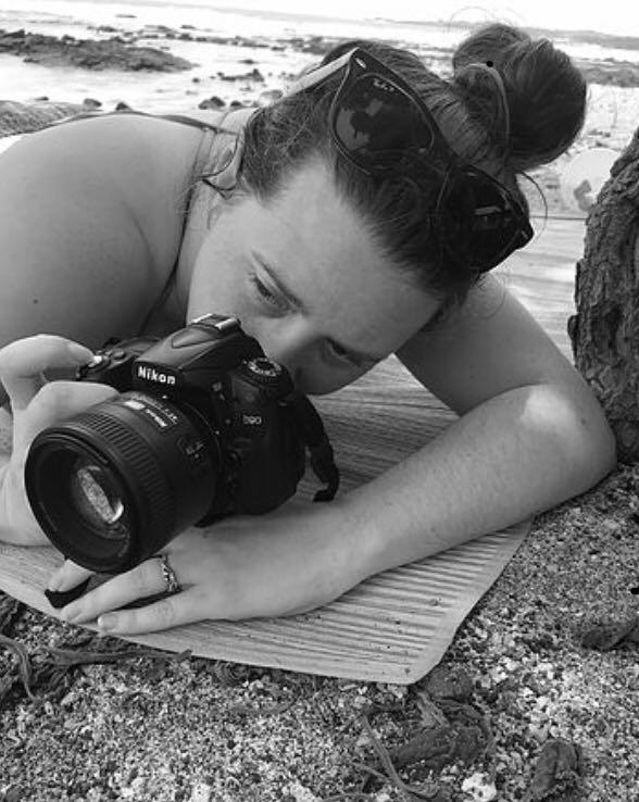 Brooke Ratzat Photography taking a picture on the beach